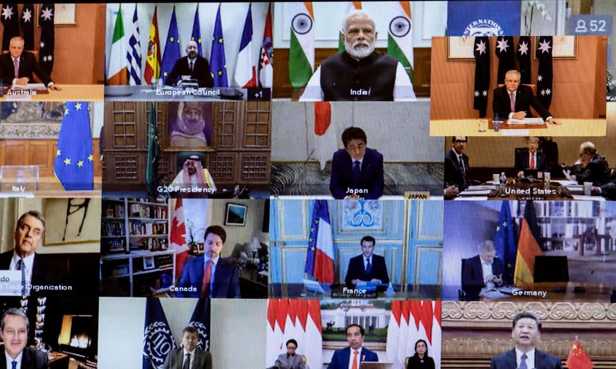 Primeiro ministro da Austrália, Scott Morrison, no topo em destaque à direita, e os demais líderes do G20 durante conferência sobre a covid-19 (Foto: Gary Ramage / POOL / AFP)