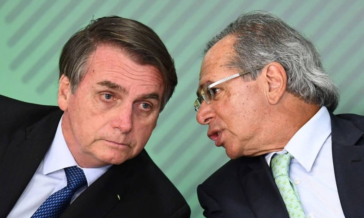 O presidente Jair Bolsonaro e o ministro da Economia, Paulo Guedes (Foto: Evaristo Sá/AFP)