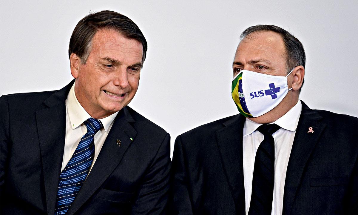Jair Bolsonaro e Eduardo Pazuello. Foto: Evaristo Sá/AFP