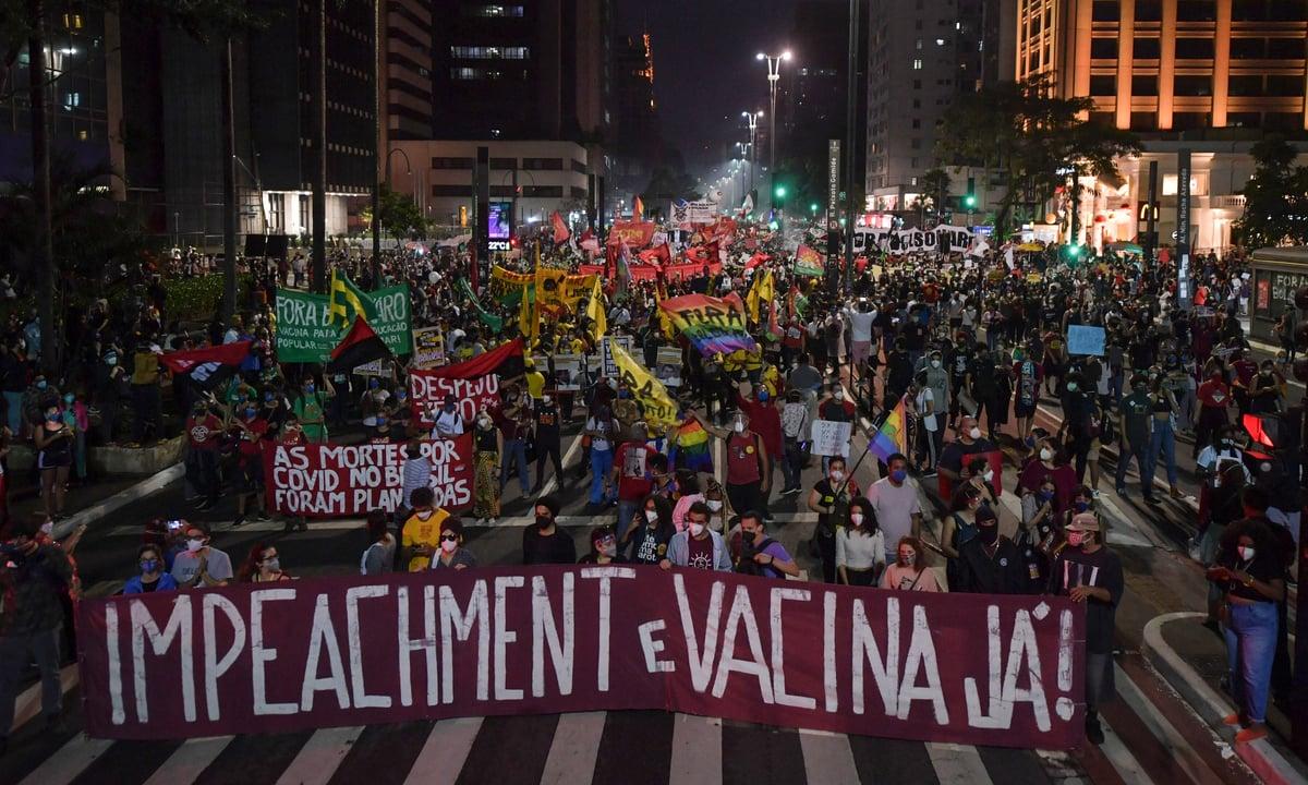 Manifestações por todo o Brasil pediram derrubada do presidente Jair Bolsonaro. (Foto: Nelson Almeida/AFP)